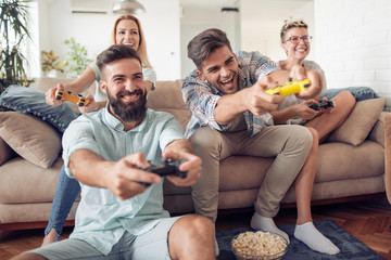 Beautiful couples playing video games on console