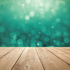 Christmas holiday background with rustic table over green bokeh for product montage
