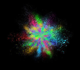 Explosion of colored cosmetic powder on black background