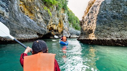 Group of tourists on a kayak.Travel by boat around Ko Phi enjoy the nature of the sea and islands in the summer at Mu Ko Ang Thong National Marine Park, Surat Thani province, Thailand ,16:9 widescreen
