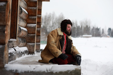 Traditional winter costume of peasant medieval age in russia