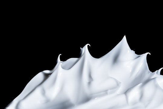 White cosmetic cream close-up macro texture background isolated on black