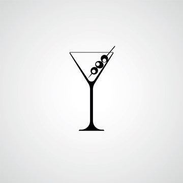 A glass for a martini. Cocktail with olives. Black silhouette. V