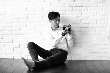Asian man with a camera black and white