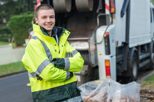 portrait of young smiling refuse collector