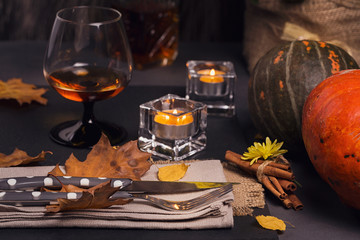 Table setting with autumn decoration for Thanksgiving.