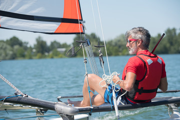 sailing man on sailboat during competition