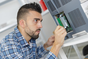 electrician works with machine electronic