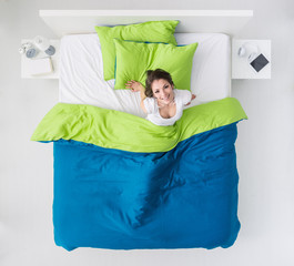 Woman waking up in her bed