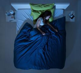 Woman sleeping in the bedroom