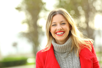 Portrait of a happy woman wearing red jacket in winter