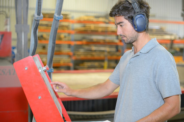 factory operator with ear protection