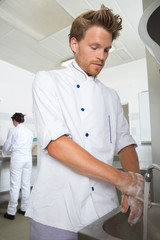 young cook washing his hand