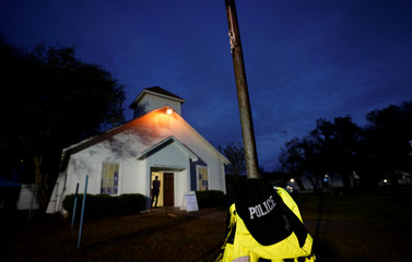 A police hat hangs outside the First Baptist Church of Sutherland Springs following the shooting attack in Texas