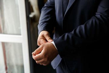 Man. People, business,fashion and clothing concept - close up of man in shirt dressing up and adjusting blue suit