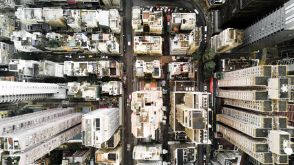 Aerial city view with crossroads and roads, houses, buildings and parking lots. Helicopter drone shot. Wide Panoramic image of Hong Kong.