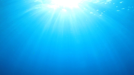 Abstract underwater blue background and sunlight