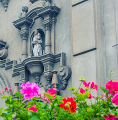 geraniums in front of a church