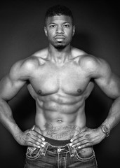 Body portrait of African American body builder black and white