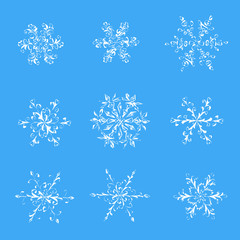 A set of hand-drawn black-and-white snowflake