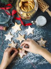 Christmas Star Cookies. Woman packing christmas gift