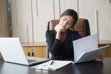 Asian woman working  hard and feeling dizzy at office, woman with office syndrome concept.