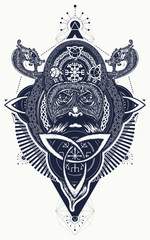 Viking tattoo and t-shirt design. Northern warrior. Celtic emblem of Odin. Northern dragons, viking helmet, ethnic style. Viking warrior tattoo