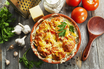 Fish baked with tomatoes, sour cream and cheese