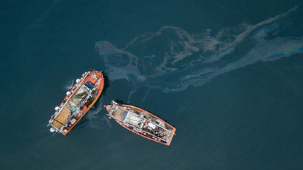 Fishing boats and oil spill