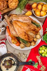 Christmas holiday table setup. Traditional christmas food with christmas festive holiday decor and holiday background