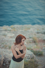 Journal Calendar red hair goddess queen seamaid awaiting her man seaman fisherman on rocky beach cape dreaming about love and family wearing stylish cosy white black clothes