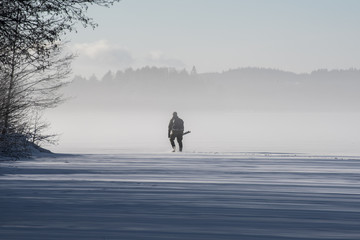 people icefishing on a lake in sweden