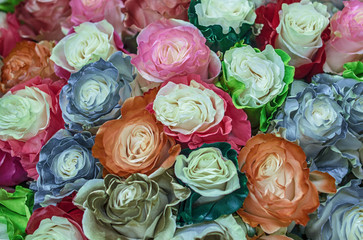 Large bouquet of unusual roses. The flowers chameleons with the silver, gold, bronze, green, orange, blue, pink and red petals on the edges