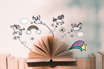 A fairy tales open book with unicorn and rainbow illustration doodles- imagination concept