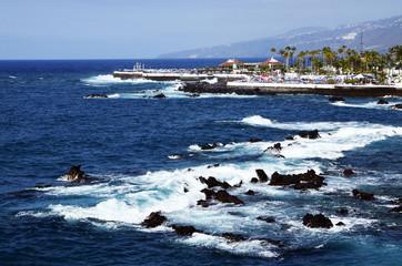 Beautiful coastal view of Puerto de la Cruz,Tenerife,Canary Islands,Spain.Ocean bay and volcanic rocks in the water.Selective focus.