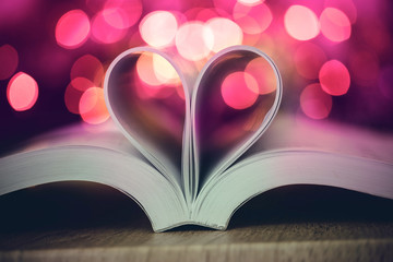 The Book page decorate to heart shape with celebration bokeh light for love and romance of valentines day concept