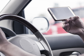 Holding smartphone while driving