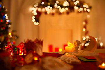 Angel Decoration, Feather and Paper Letters over Defocused Christmas Lights Background, Xmas Night Eve Scene