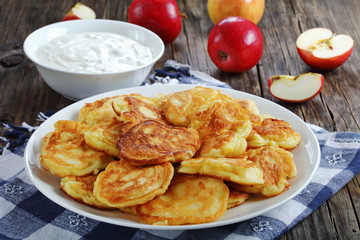 Pancakes with apple and sour cream