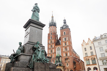 St. Mary's basilica and Adam Mickiewicz monument in Krakow Market Square, Poland