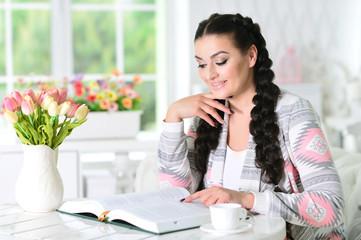 woman reading interesting book