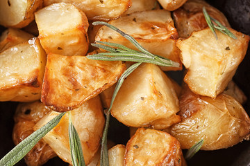 Delicious baked potatoes with rosemary, closeup