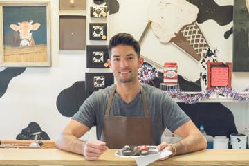 Smiling handsome confectioner portrait