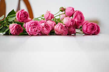 Image of pink flowers on white wooden table