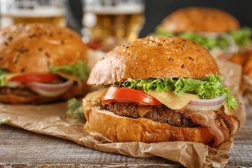 Tasty beef burger on table