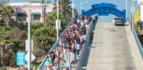 SANTA MONICA, CA - AUGUST 1, 2017: Tourists visit famous city pier in summer