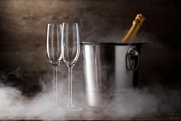 Image of two wine glasses, iron bucket