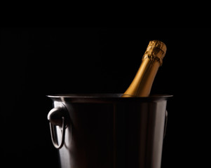 Picture of bottle of champagne in iron bucket