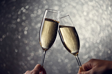 Picture of two glasses with champagne on gray background