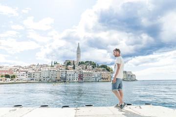 Man at the harbor of Rovinj